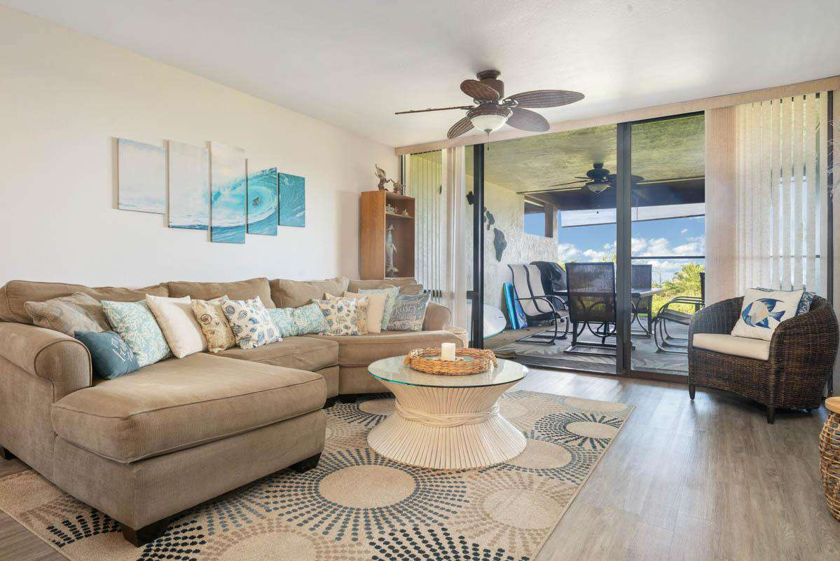 Huge living area with comfortable furnishings & TV.