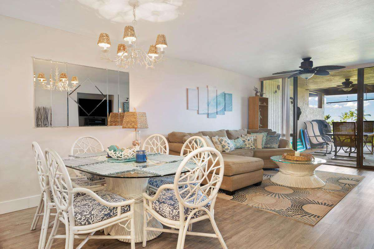 Dining for 6 indoors with additional table and chairs on the lanai.