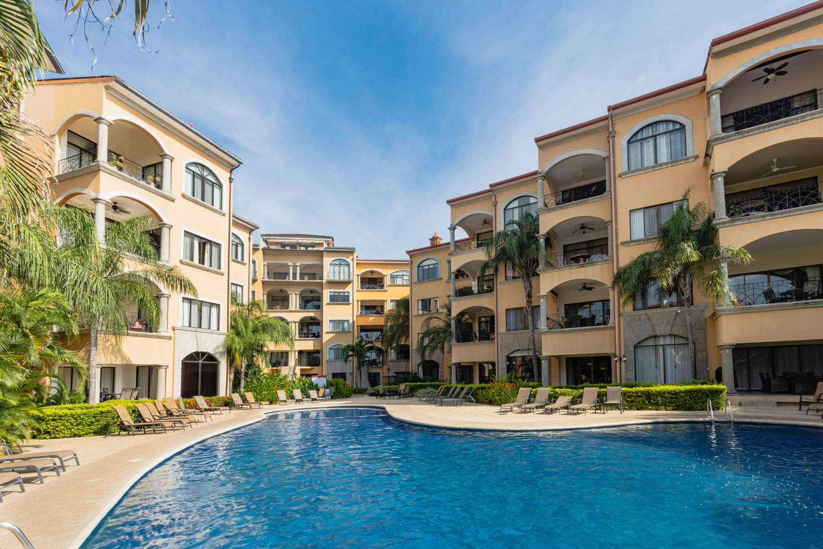 Resort style pool with waterfall at Sunrise condos