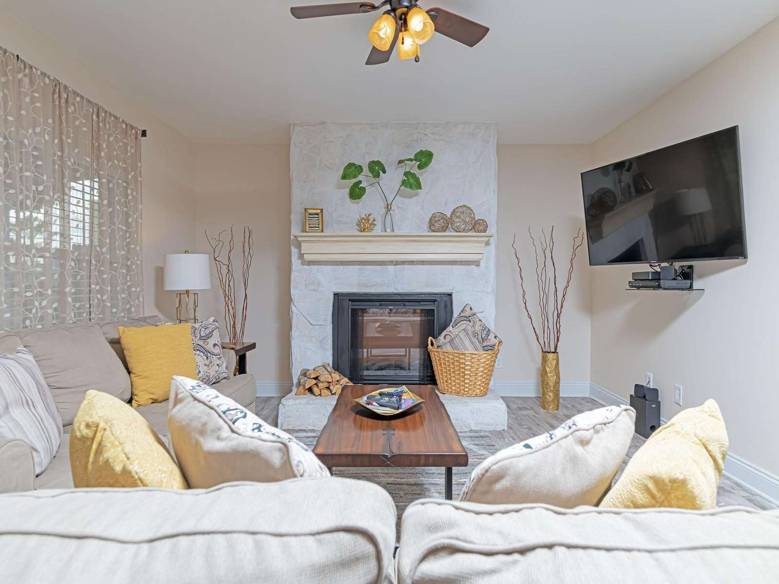 Cozy and clean living area with large smart TV!