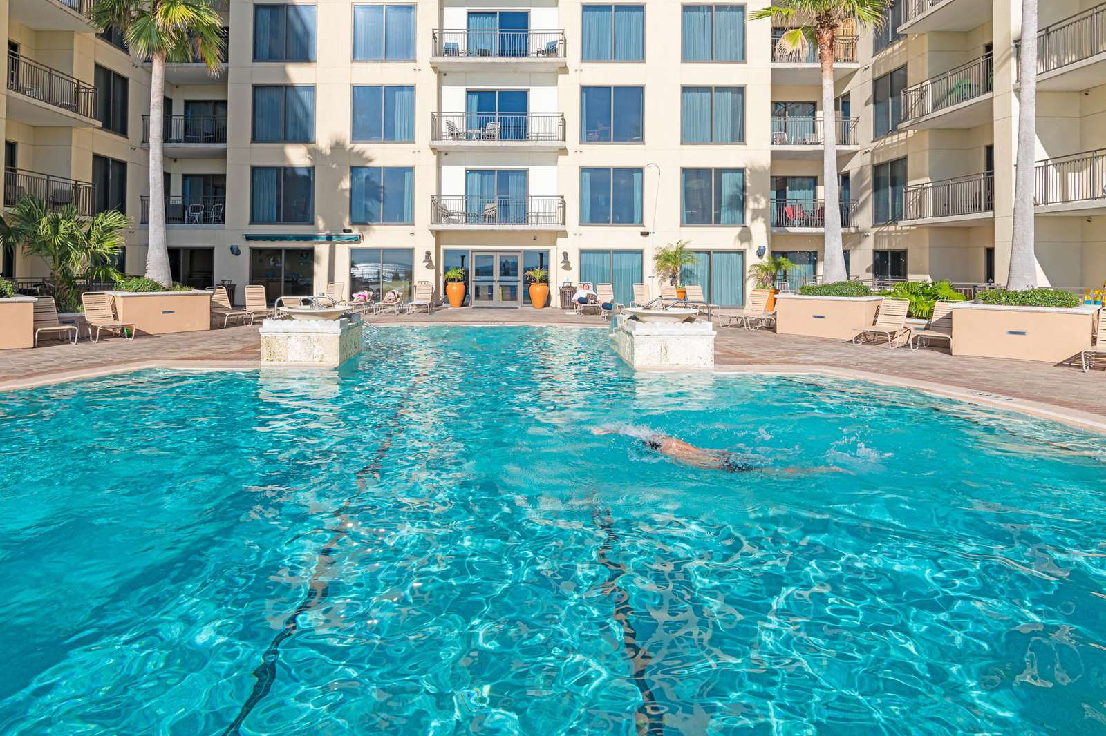 Take a few laps in the pool after a long day at the beach!