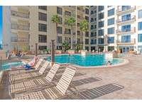 Large heated pool on the 4th floor! thumb