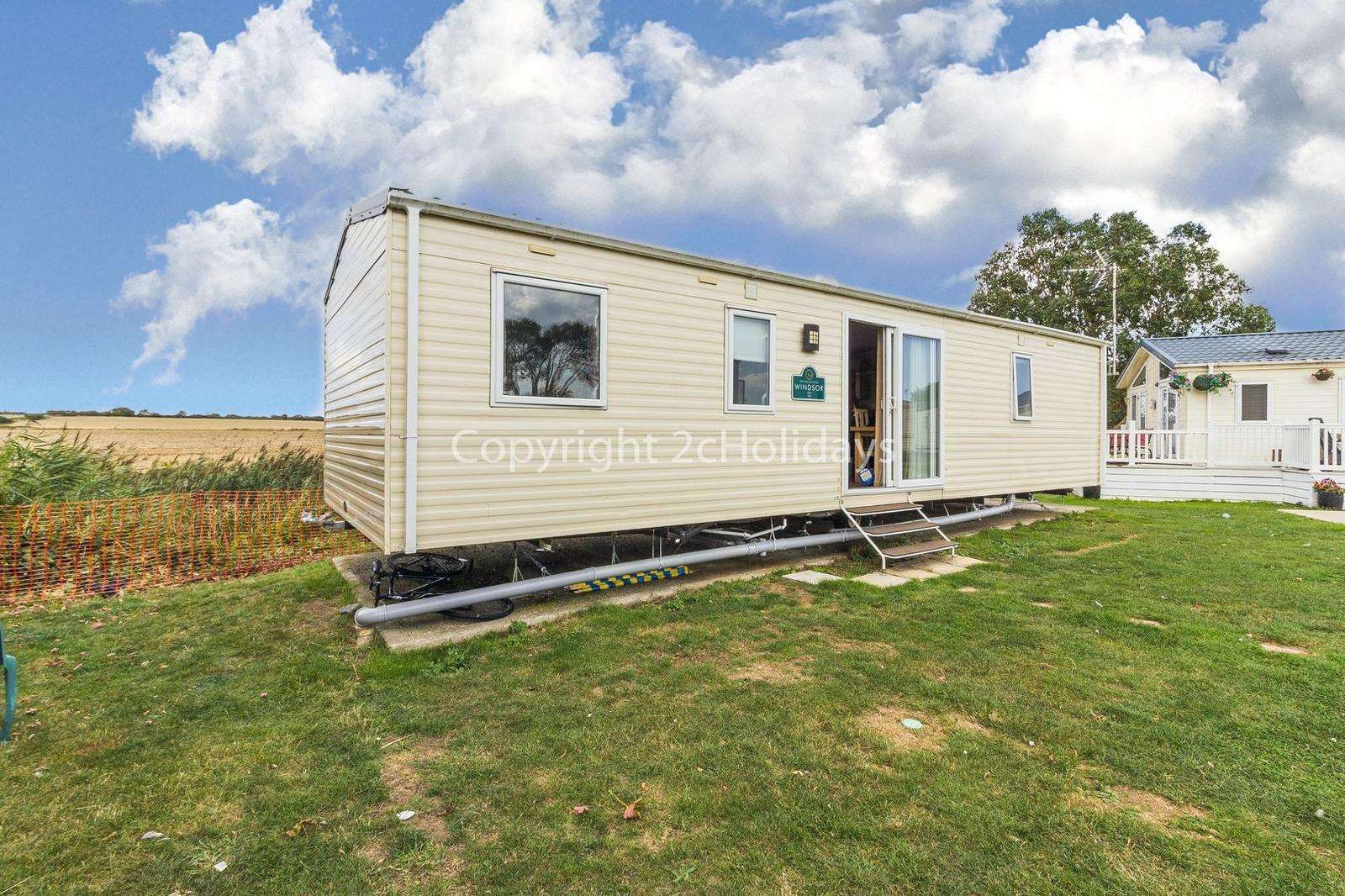 Outside furniture to relax in the sunshine and to enjoy the field views! - property