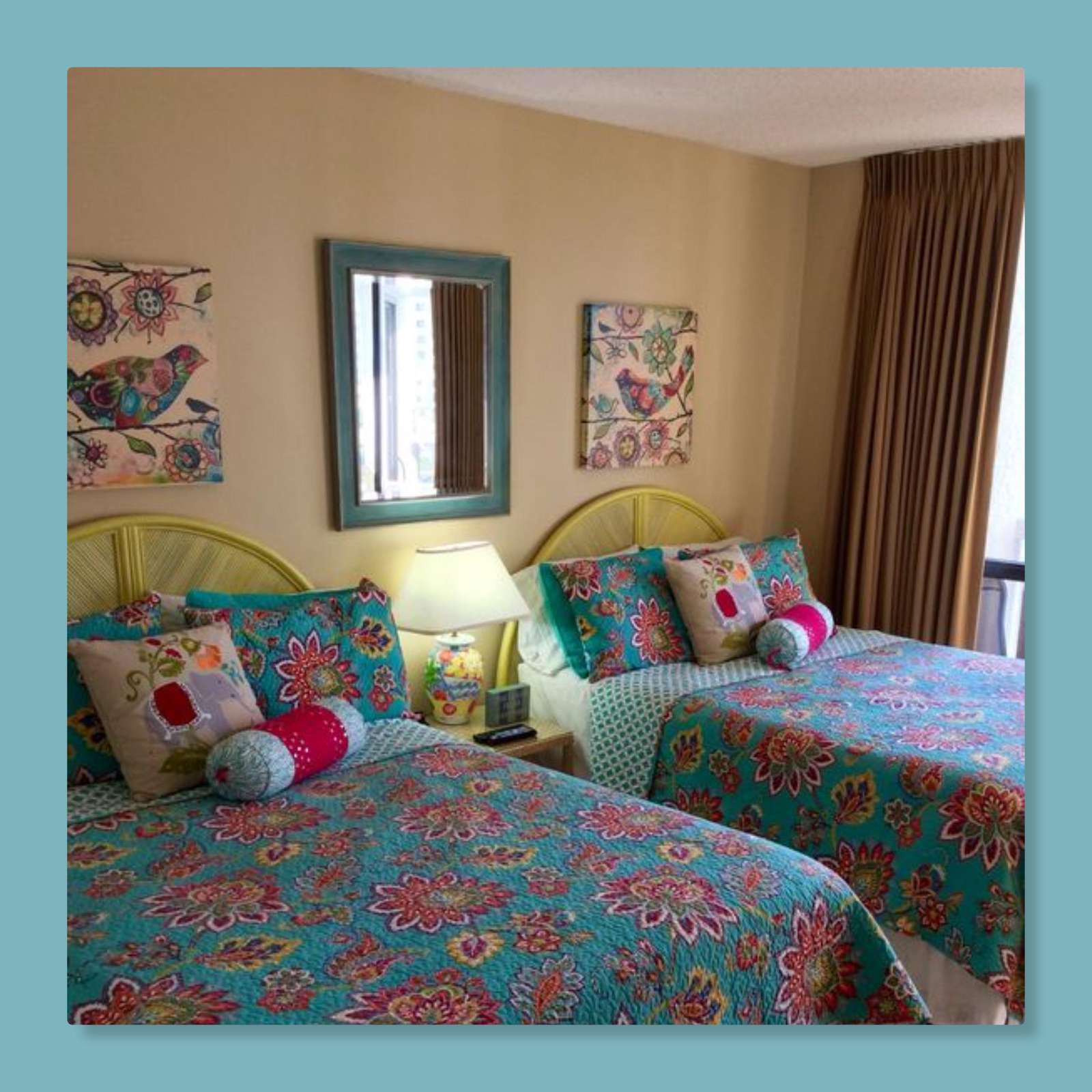 2nd bedroom features 2 queen sized beds and balcony access