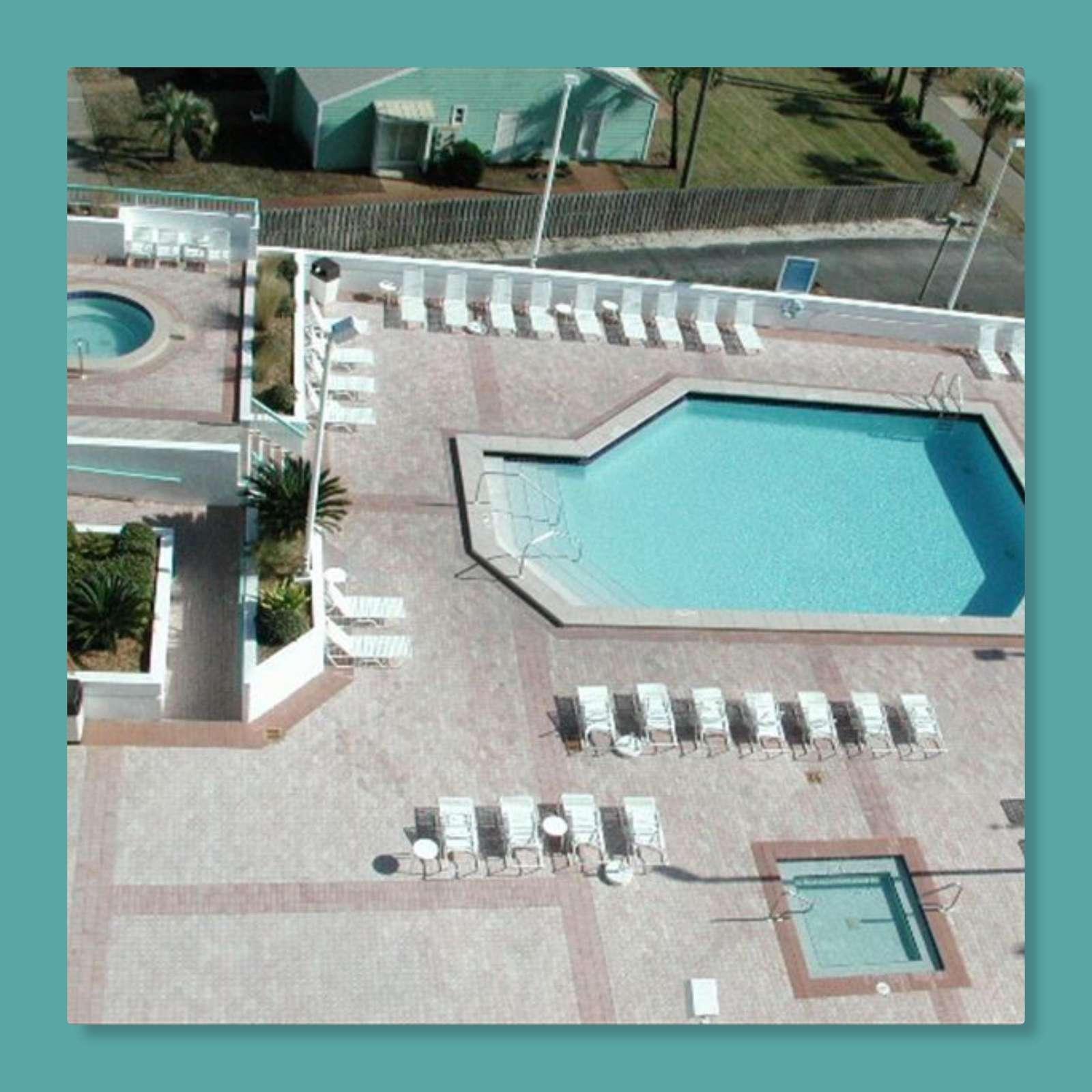 Surfside's huge pool deck features a large heated pool, 2 hot tubs, kiddie pool, tiki bar, & more!