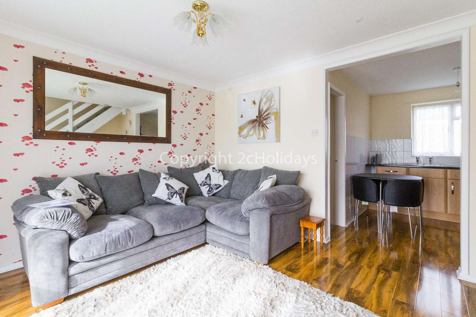 A cosy lounge with a TV included - property