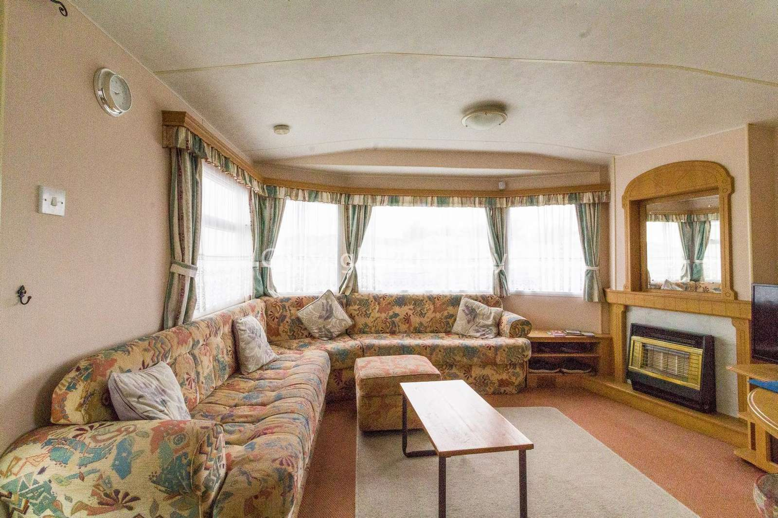 Spacious living area with a TV and gas fire