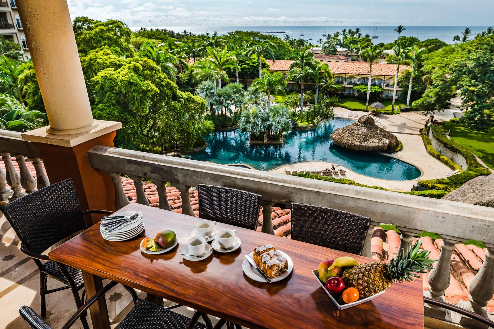 Outdoor dining with ocean and resort pool views