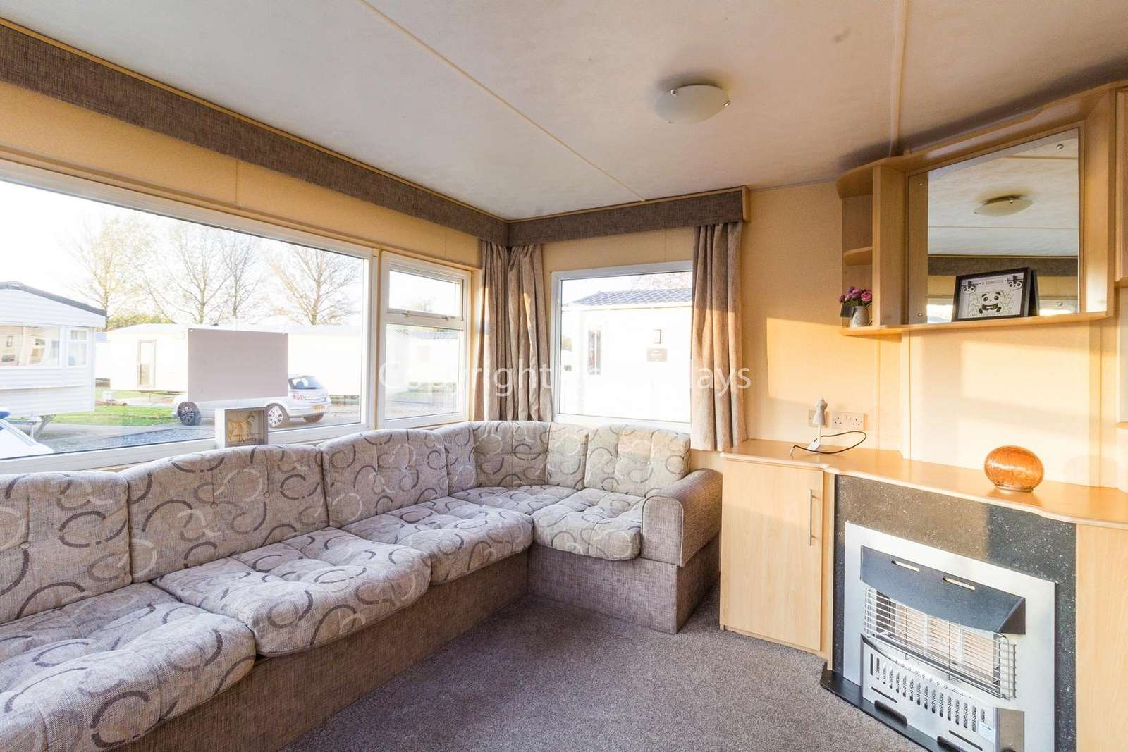 Cosy lounge with a TV and gas fire