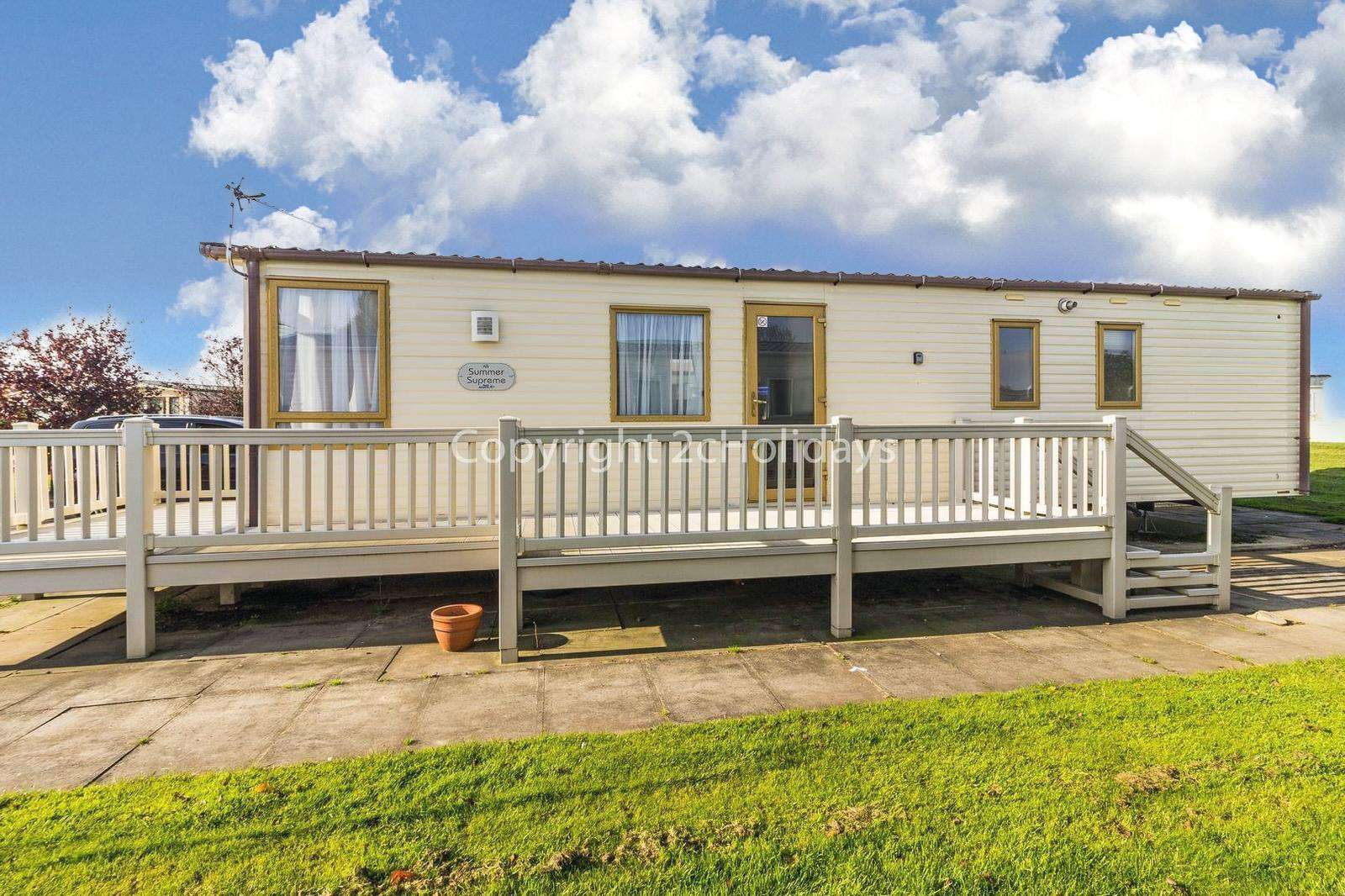 Beautiful accommodation throughout and large wrap around decking.