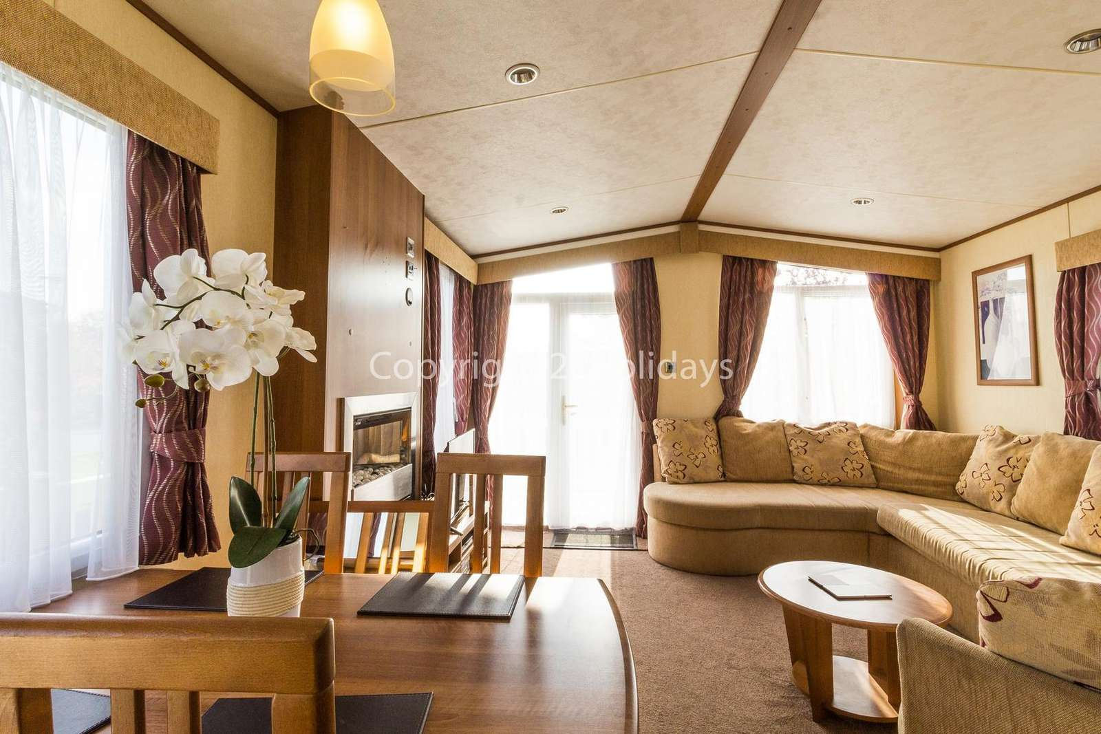 Spacious lounge/diner with double doors leading to the decking!
