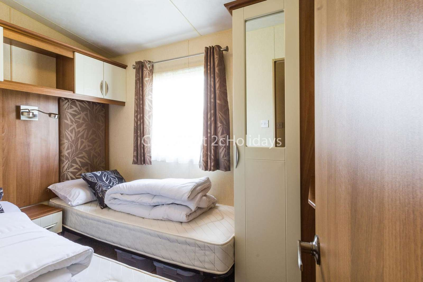 You can find plenty of storage in this twin bedroom!