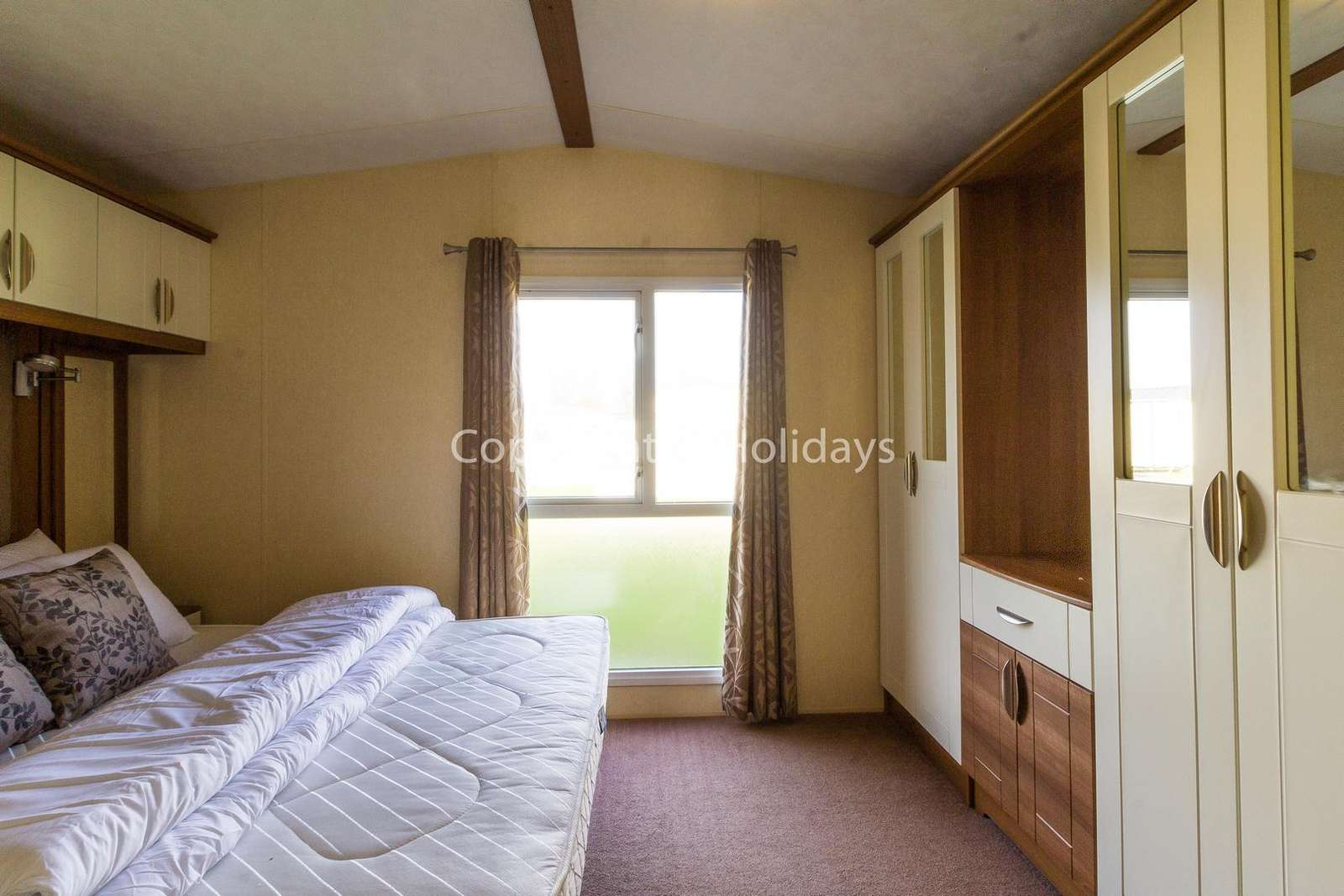 Spacious master bedroom with enough space for a travel cot!