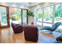 Conversation area of living room overlooking pool thumb