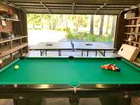 Pool table, ping pong table, corn hole and large screen TV for endless entertainment! thumb