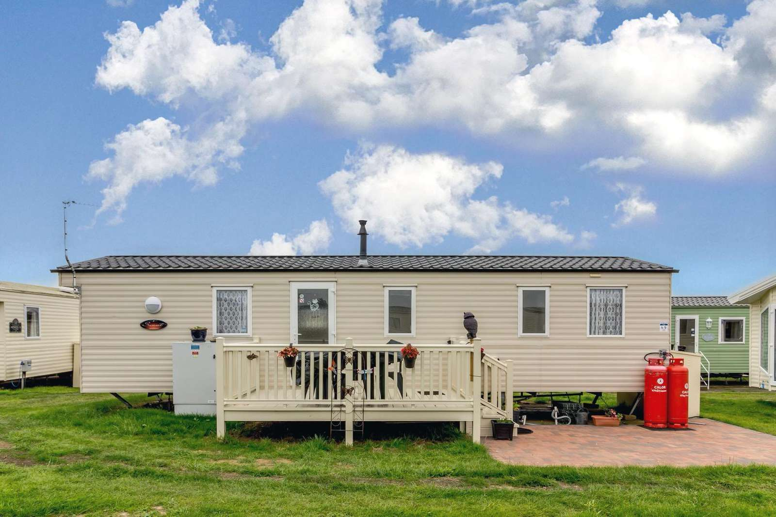 50049E – Eagle area, 2 bed, 6 berth caravan with decking, D/G & C/H. Ruby rated. - property