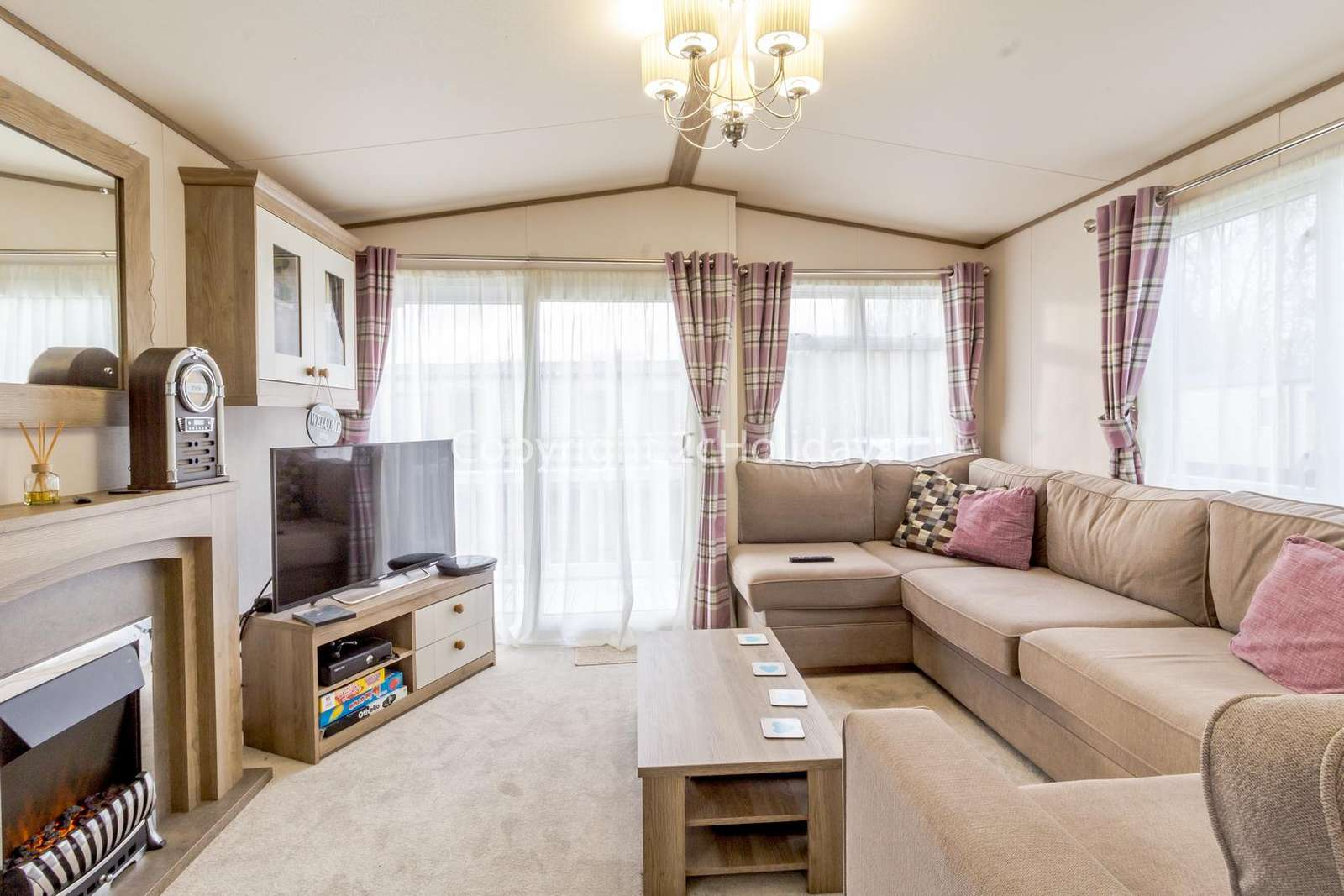 Cosy loving area with a TV and electric fire