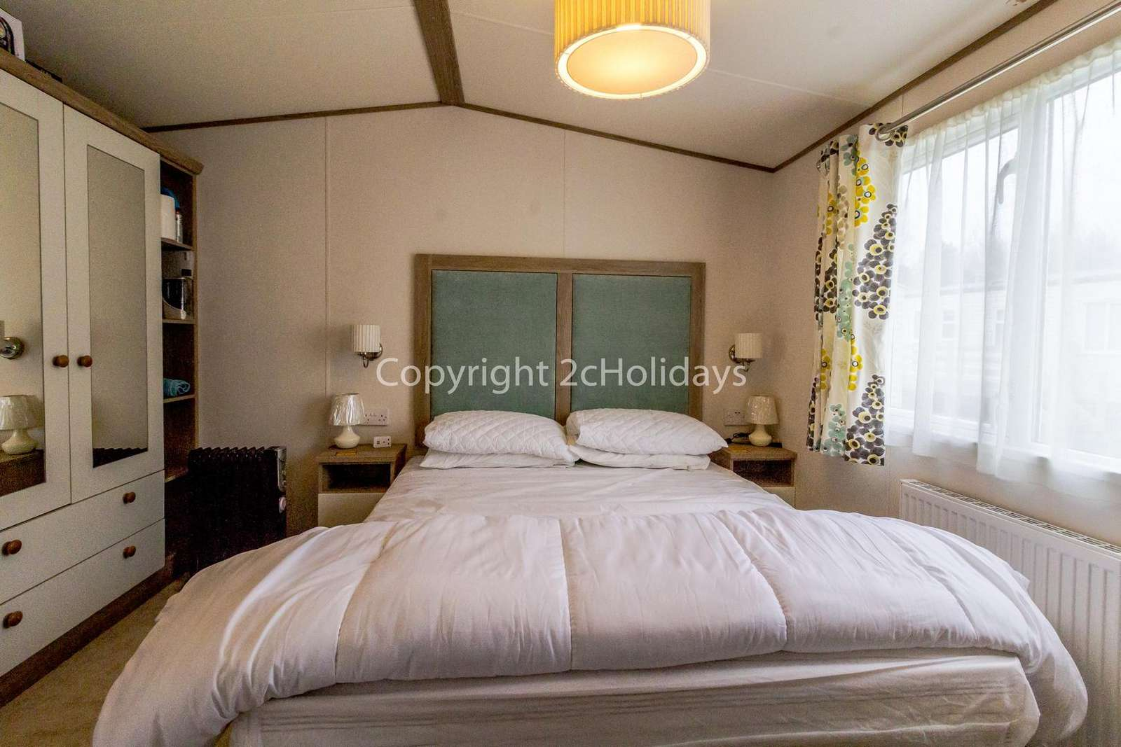 You can find plenty of storage space in this lovely master bedroom