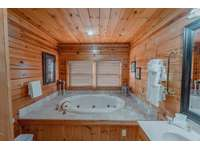 Loft bathroom with a jacuzzi tub for those relaxing evenings you crave thumb