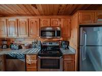 The kitchen is the first place you see when entering the cabin thumb
