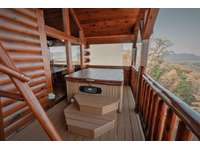 Hot tub is located on the 2nd level balcony thumb