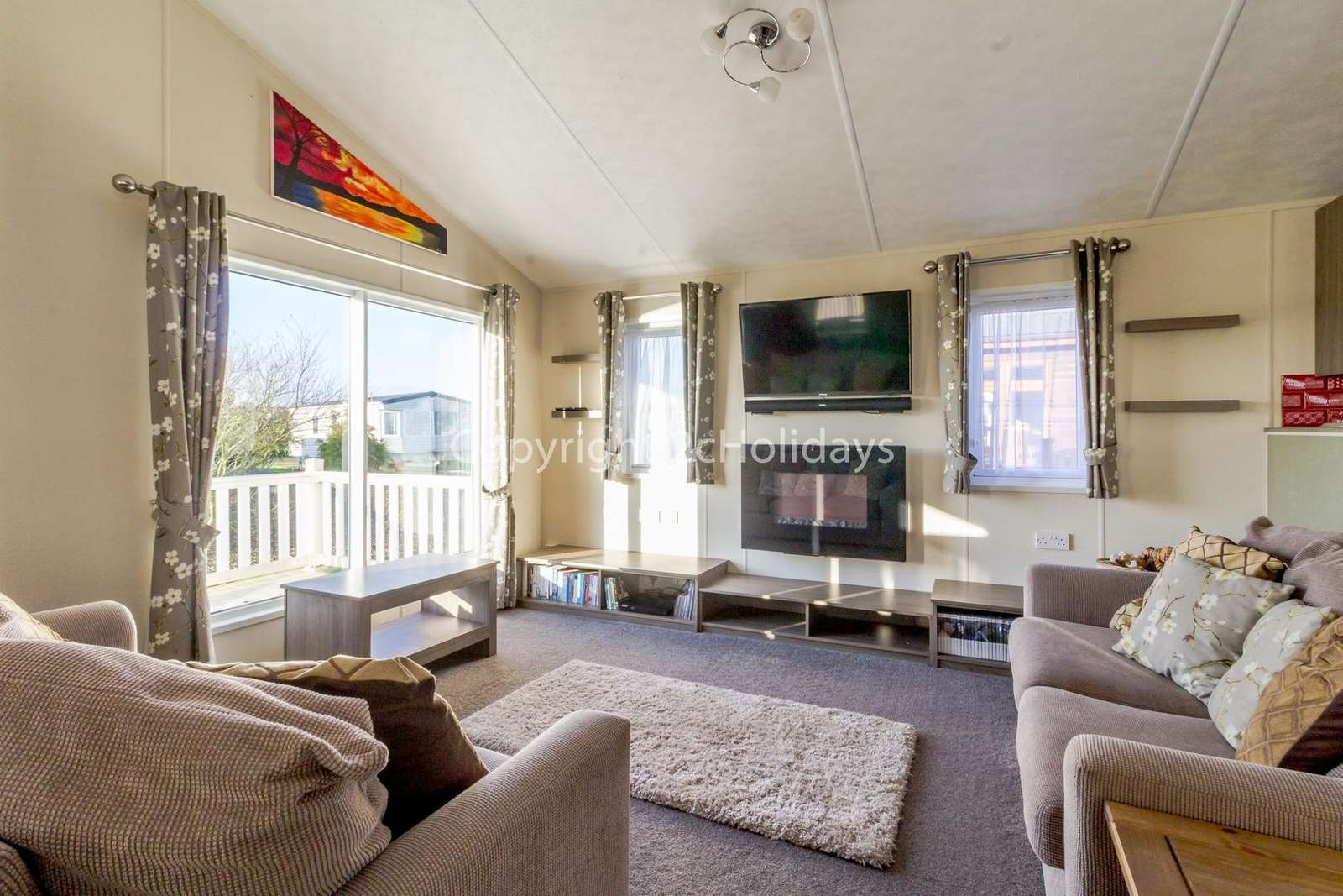 Cosy lounge with French doors leading onto the decking
