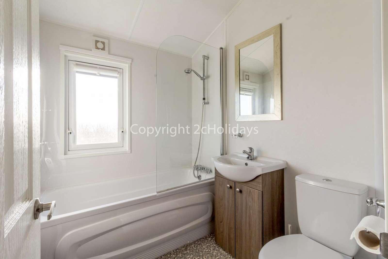 Spacious family washroom with a bath!