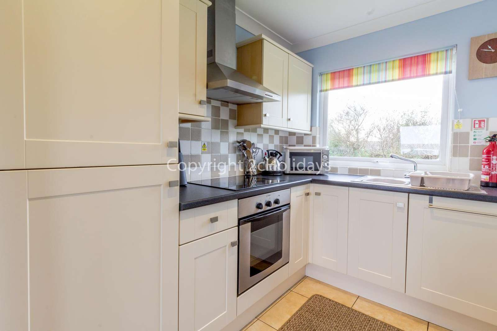 A lovely modern kitchen with a full size oven and washing machine!