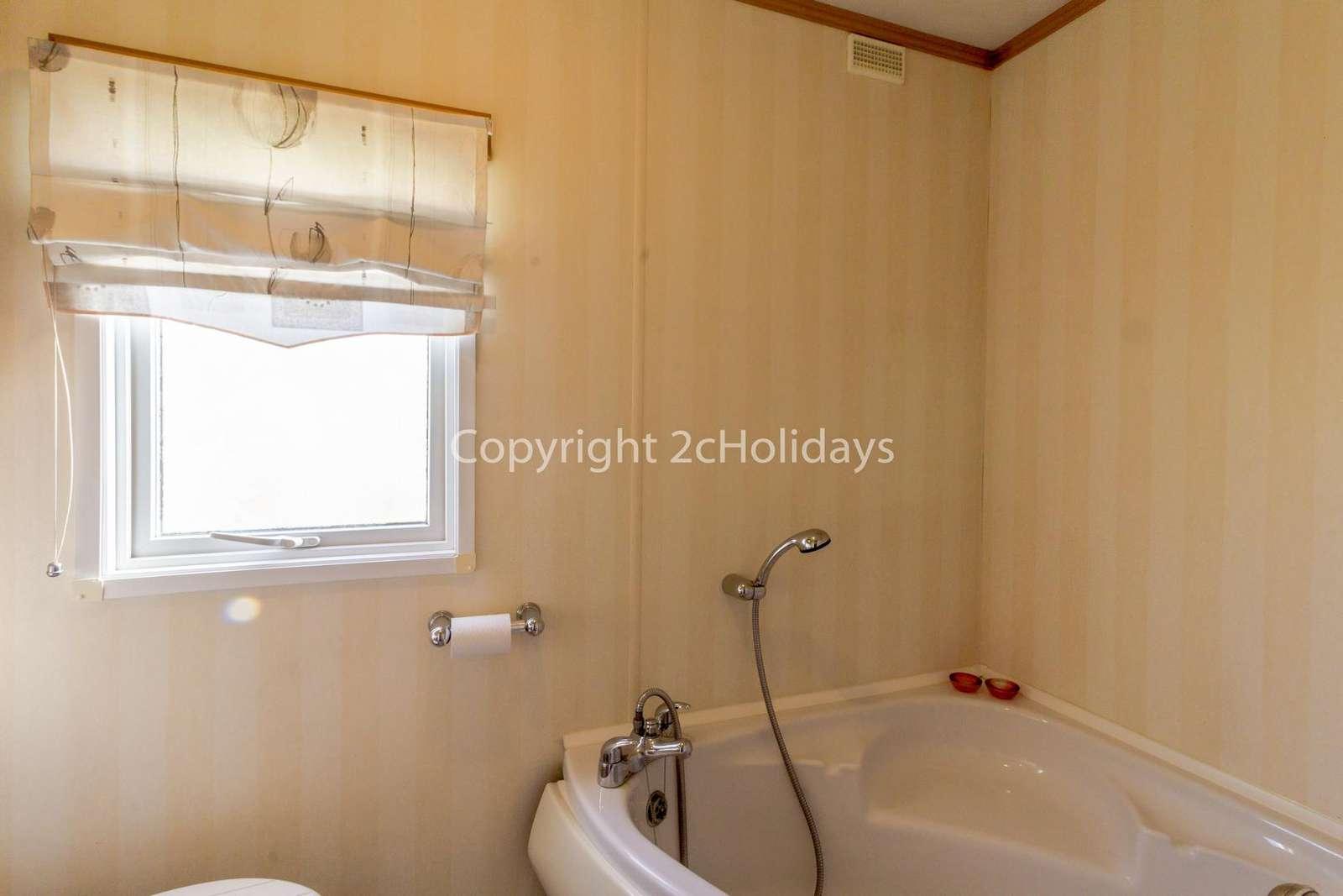 Family washroom with a corner bath!