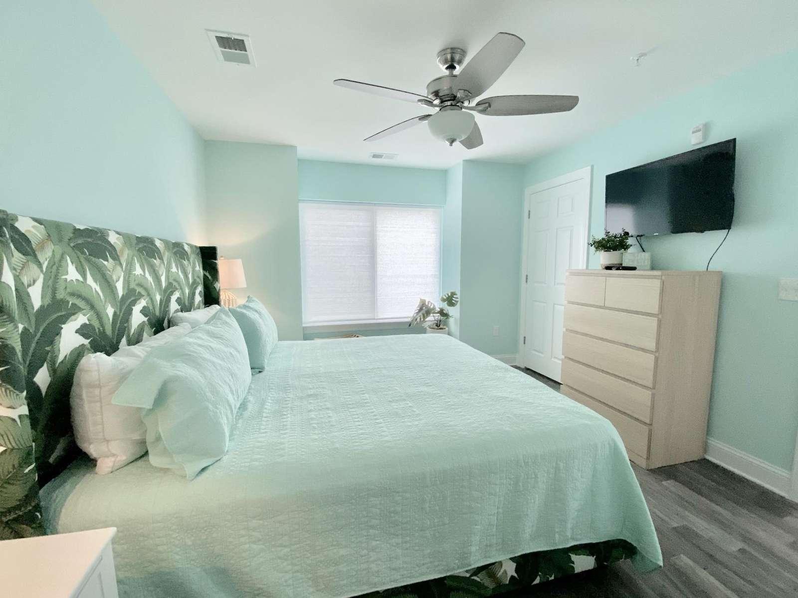 Master bedroom, flat screen TV, ceiling fan