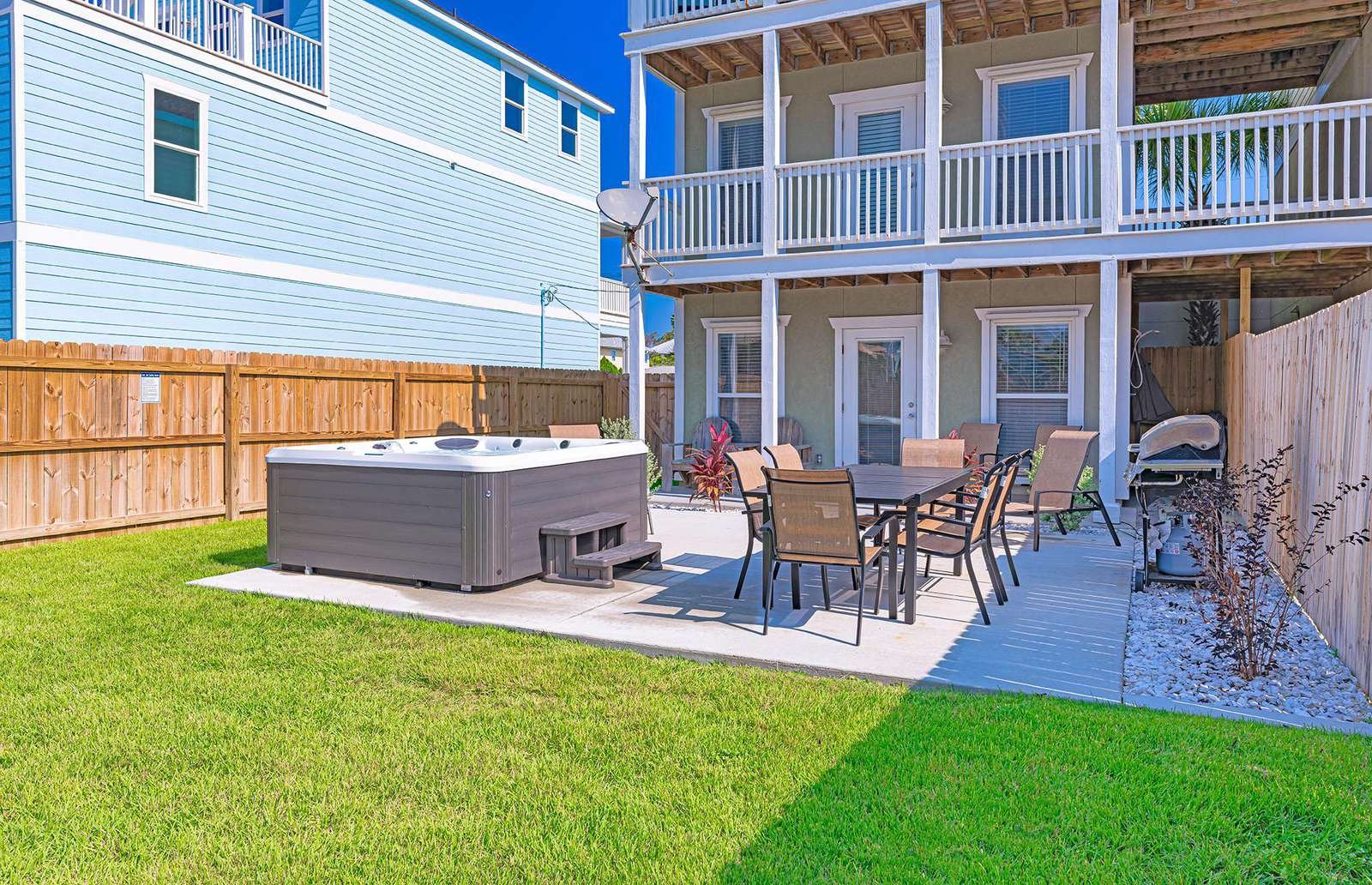 Gas grill, patio, furniture and lush maintained grounds!