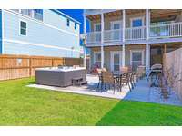 Gas grill, patio, furniture and lush maintained grounds! thumb