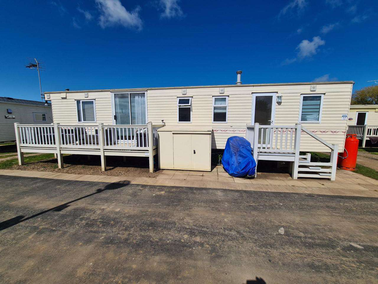 21011C – Chequers area, 3 bed, 6 berth caravan with decking. Ruby rated. - property