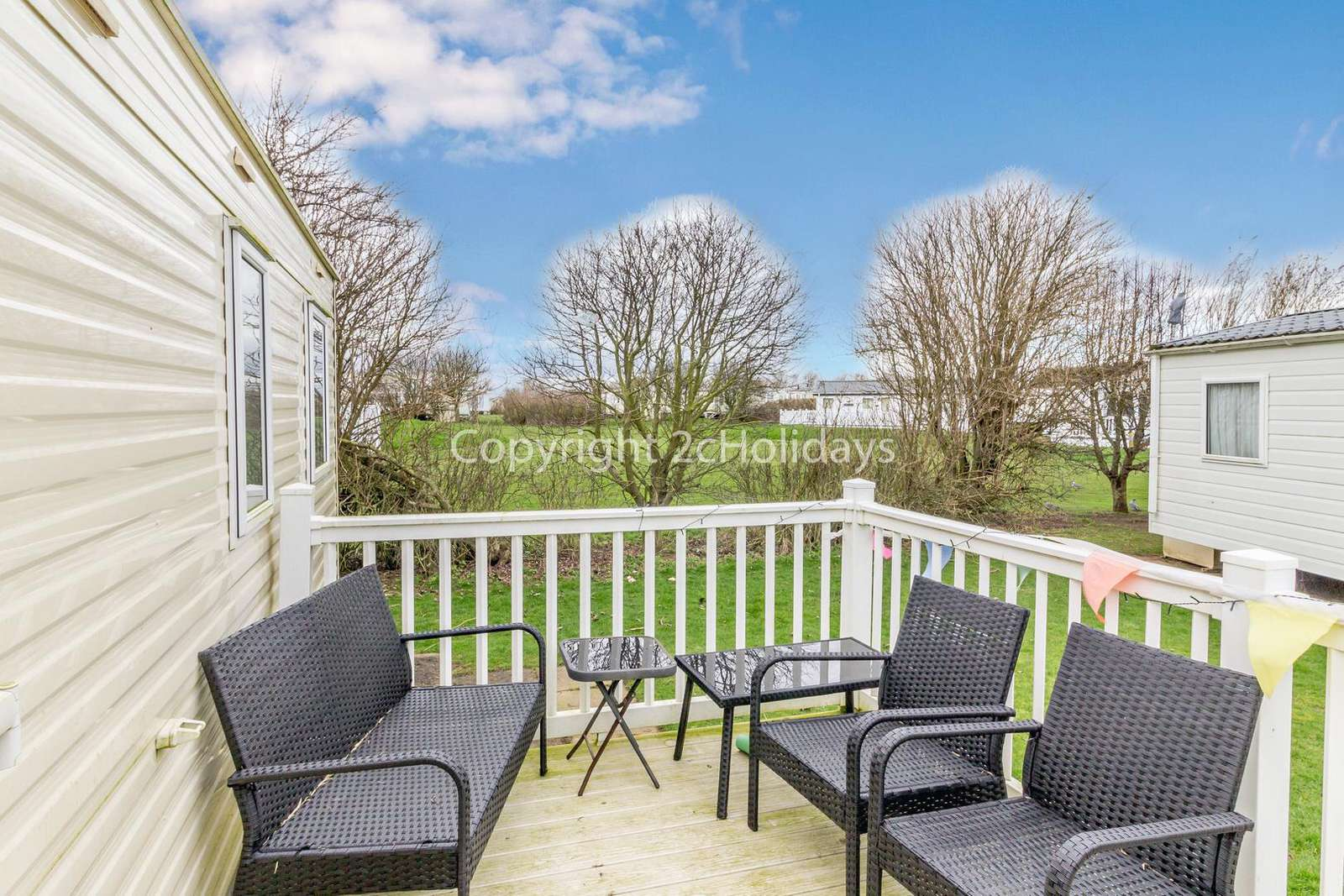 Enclosed decking with outdoor furniture for you to enjoy use of, perfect for families!