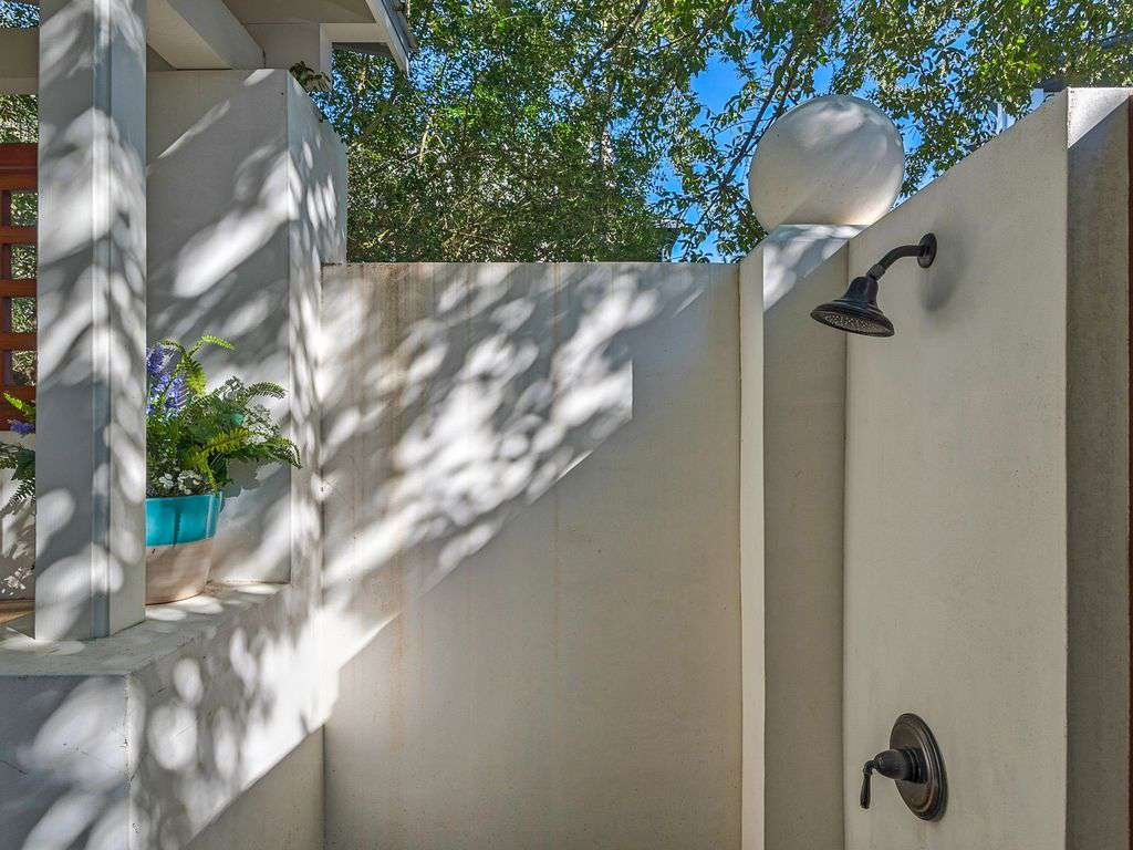 Outdoor shower upon entry to courtyard