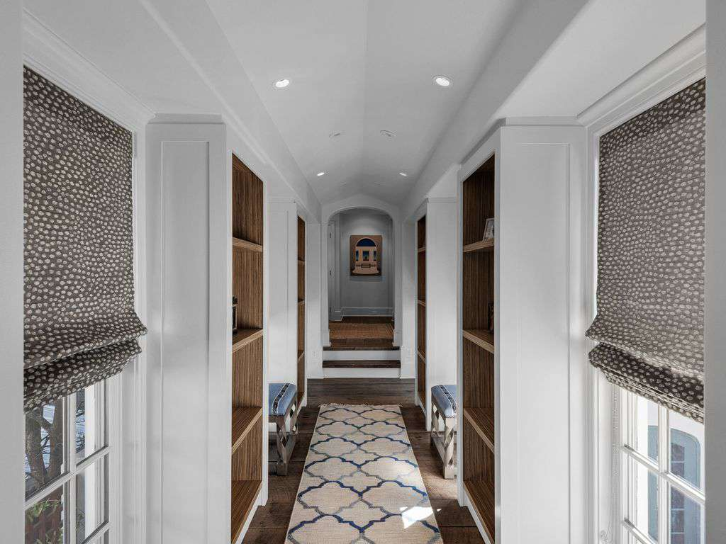 Walk way on second floor separates the king master from the two queen bedrooms