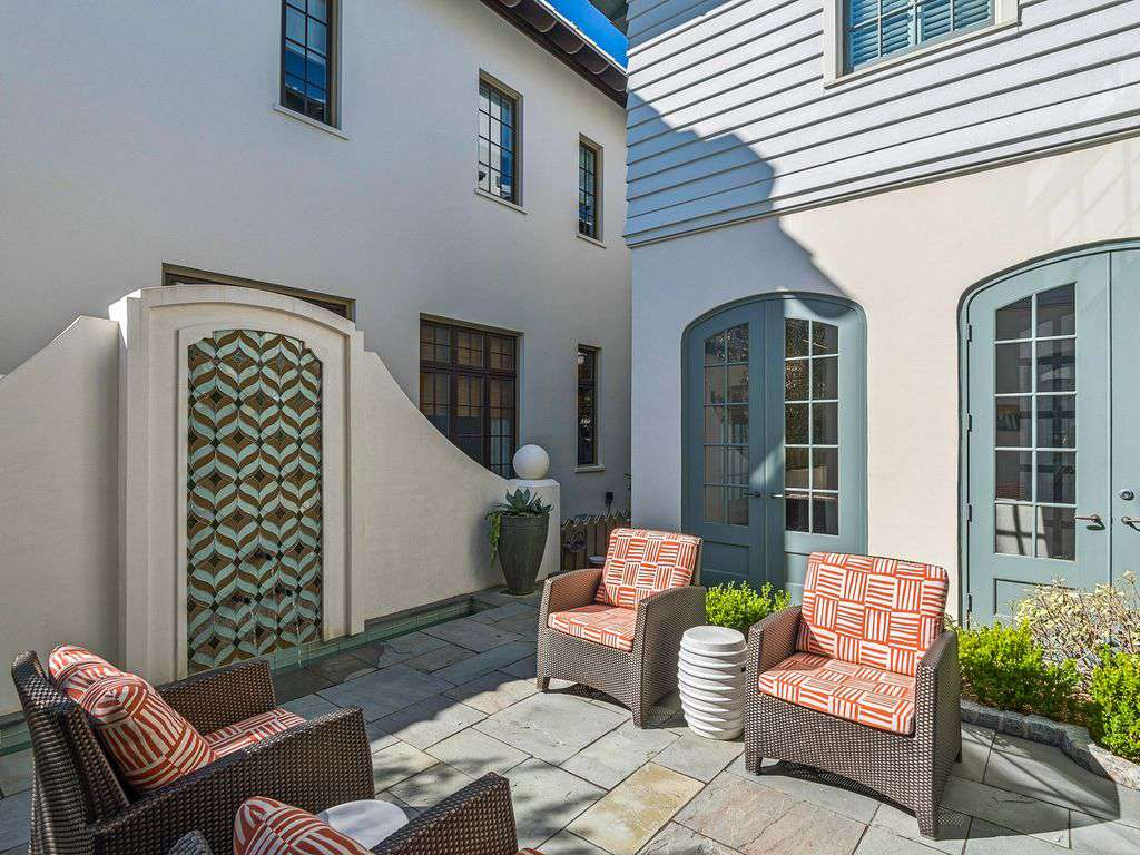 Outdoor courtyard off family room  with water fountain