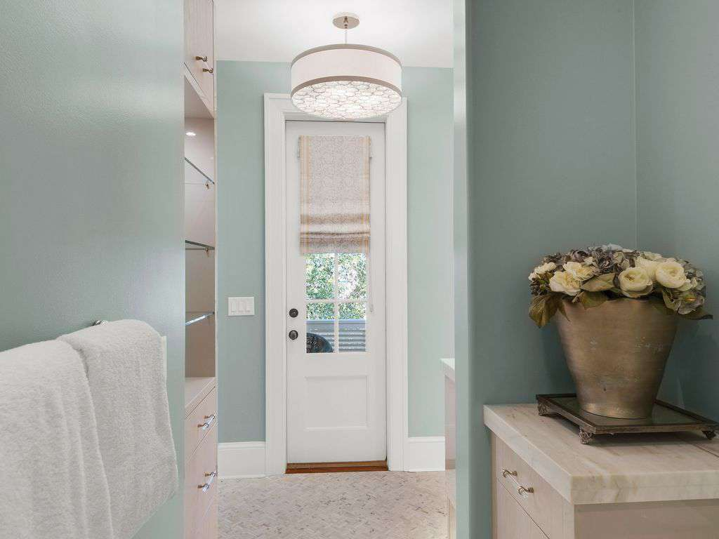 Door leading to balcony private shower  and lavatory area  in master ensuite
