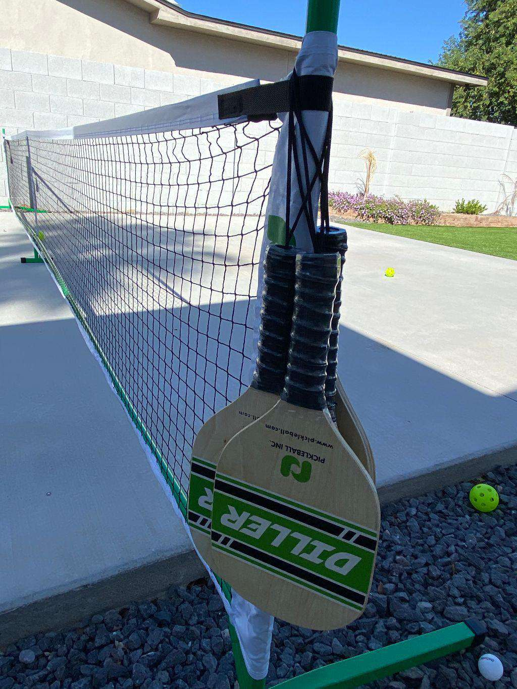 Pickle Ball Paddles Included.