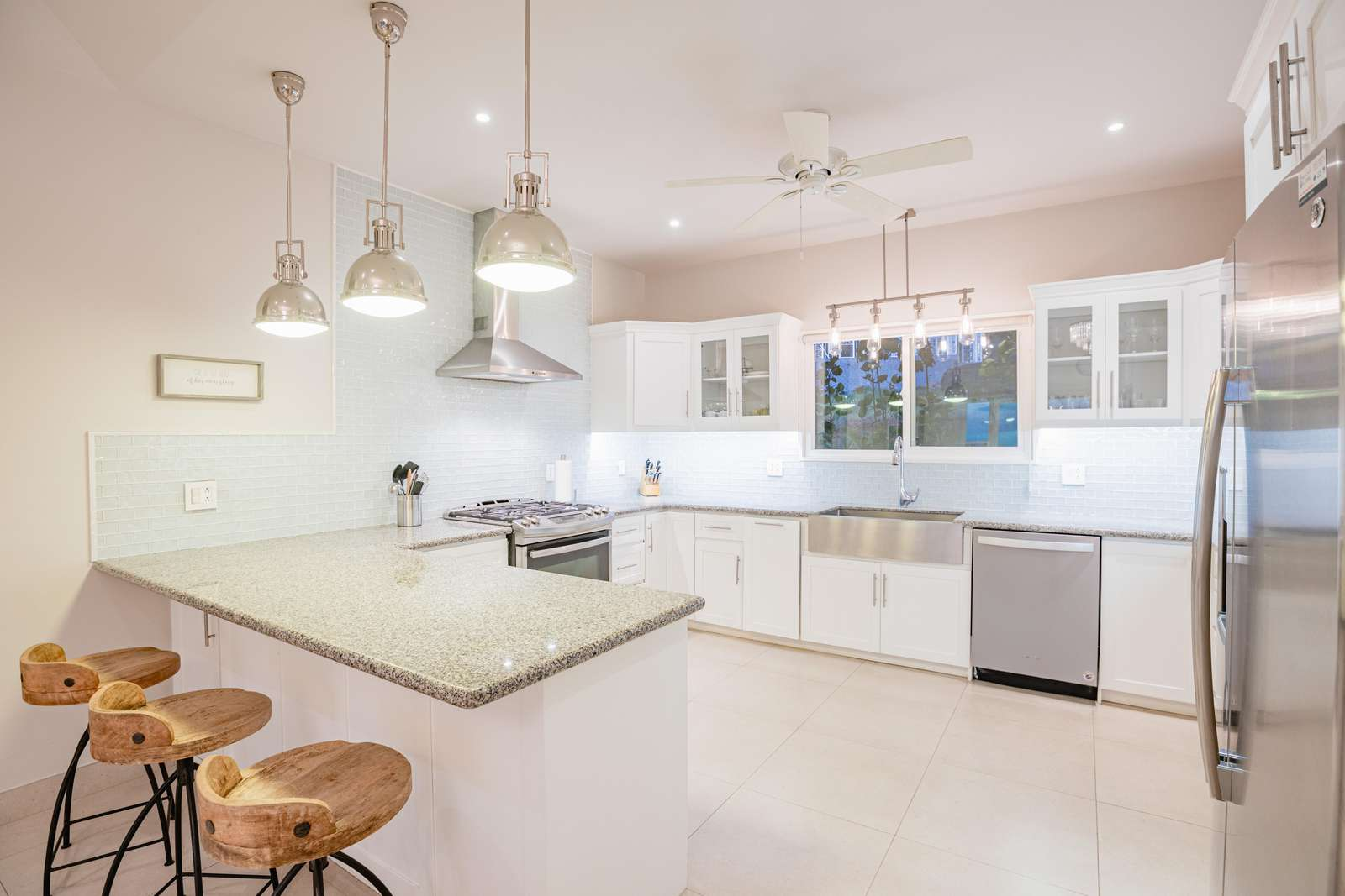 Fully stocked gourmet kitchen, with breakfast bar, granite countertops and stainless steel appliances