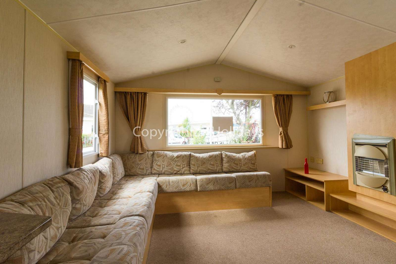 Spacious lounge area with a double sofa bed
