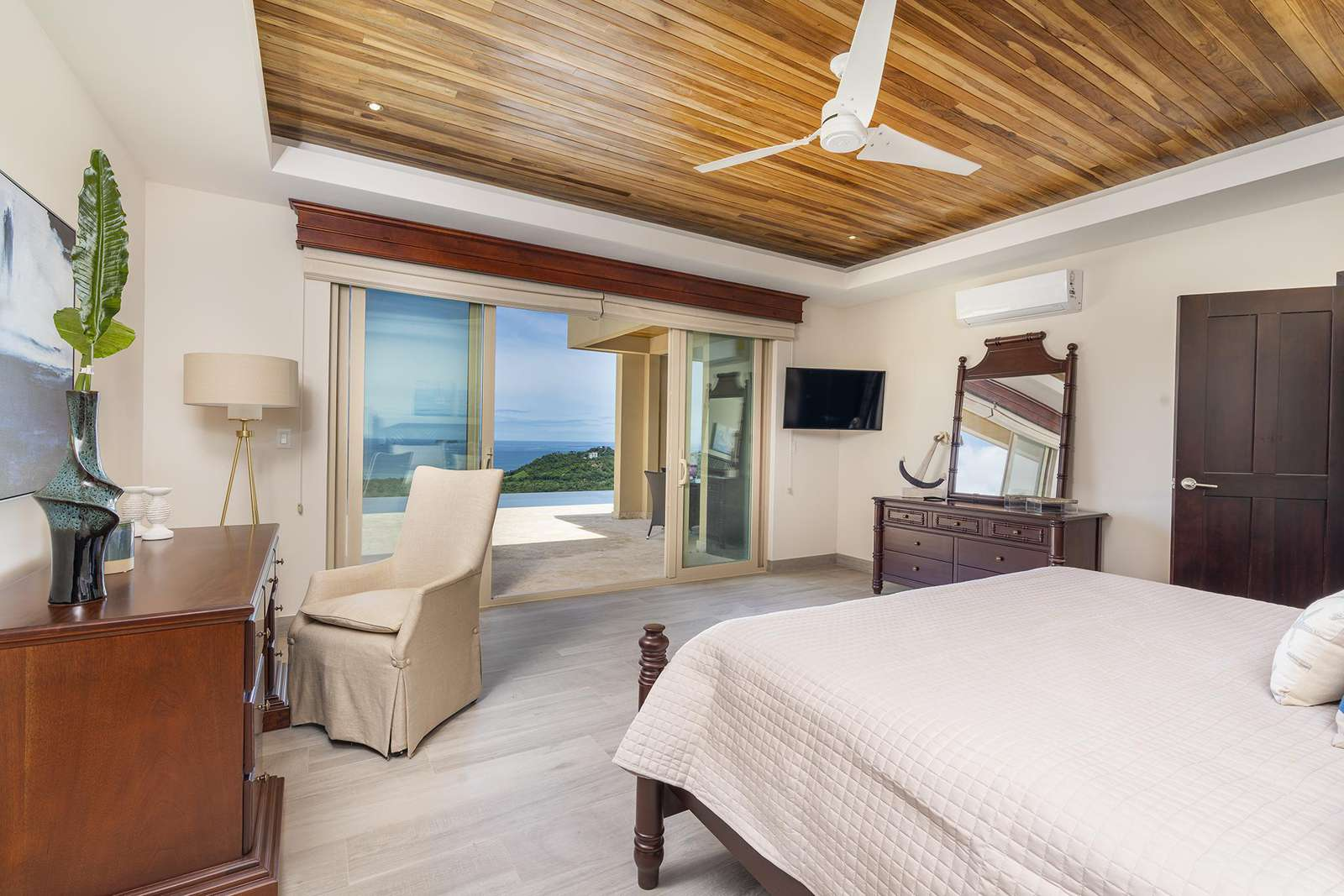 Master Suite #1, main level, king bed, private full bathroom, ocean views, access to pool and terrace areas