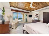 Master Suite #1, main level, king bed, private full bathroom, ocean views, access to pool and terrace areas thumb
