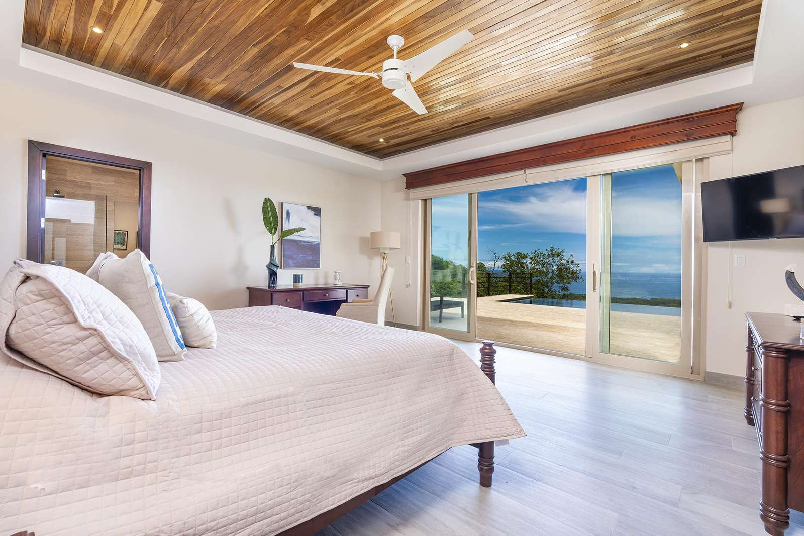 Master bedroom #1, main level, full private bathroom, walk in closet, ocean views and access to pool and terrace area