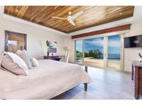 Master bedroom #1, main level, full private bathroom, walk in closet, ocean views and access to pool and terrace area thumb
