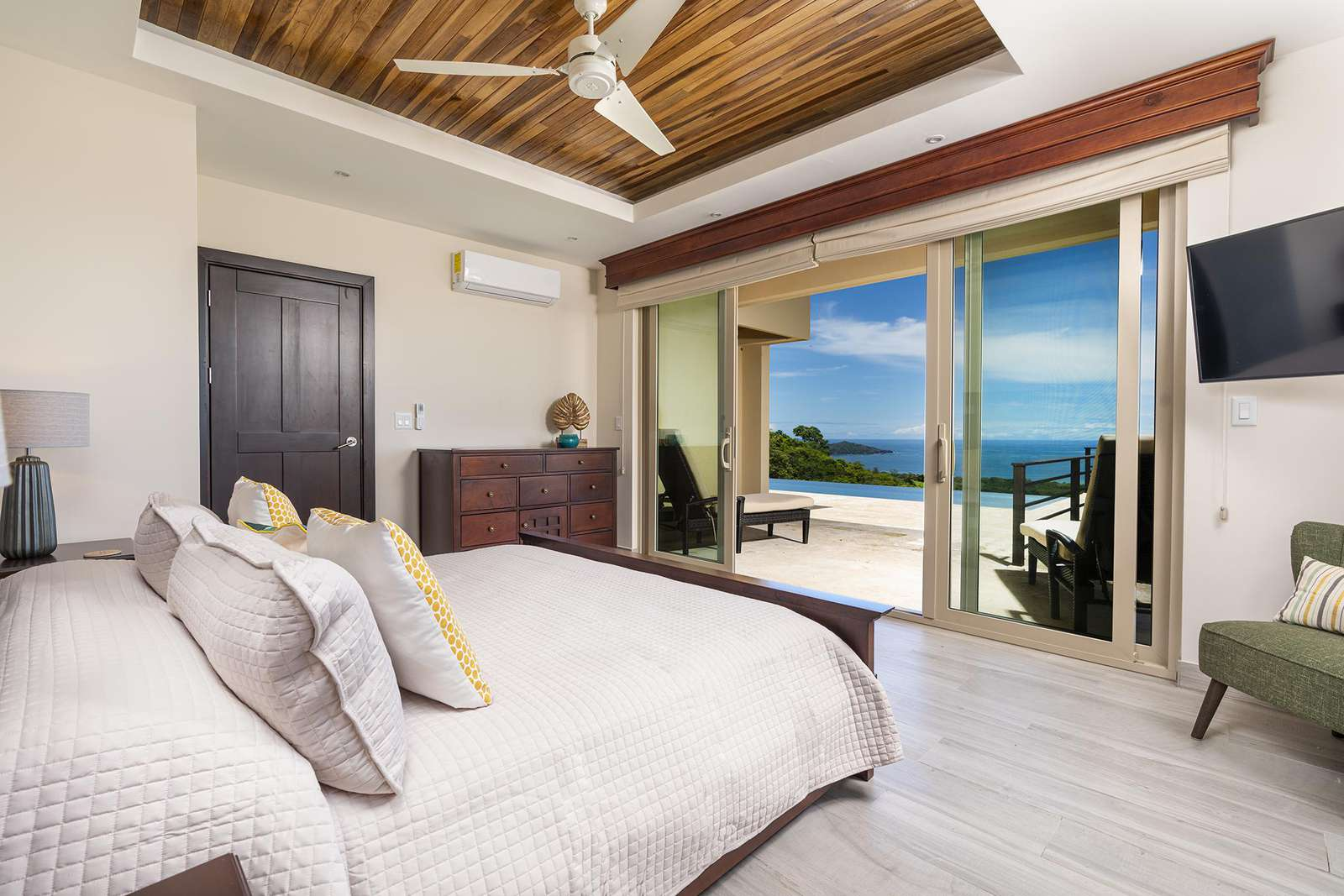 Master Suite #2, main level, king bed, Smart TV, private full bathroom, ocean views, access to pool and terrace areas