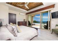Master Suite #2, main level, king bed, Smart TV, private full bathroom, ocean views, access to pool and terrace areas thumb
