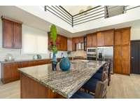Gourmet kitchen, oversized island, granite countertops thumb