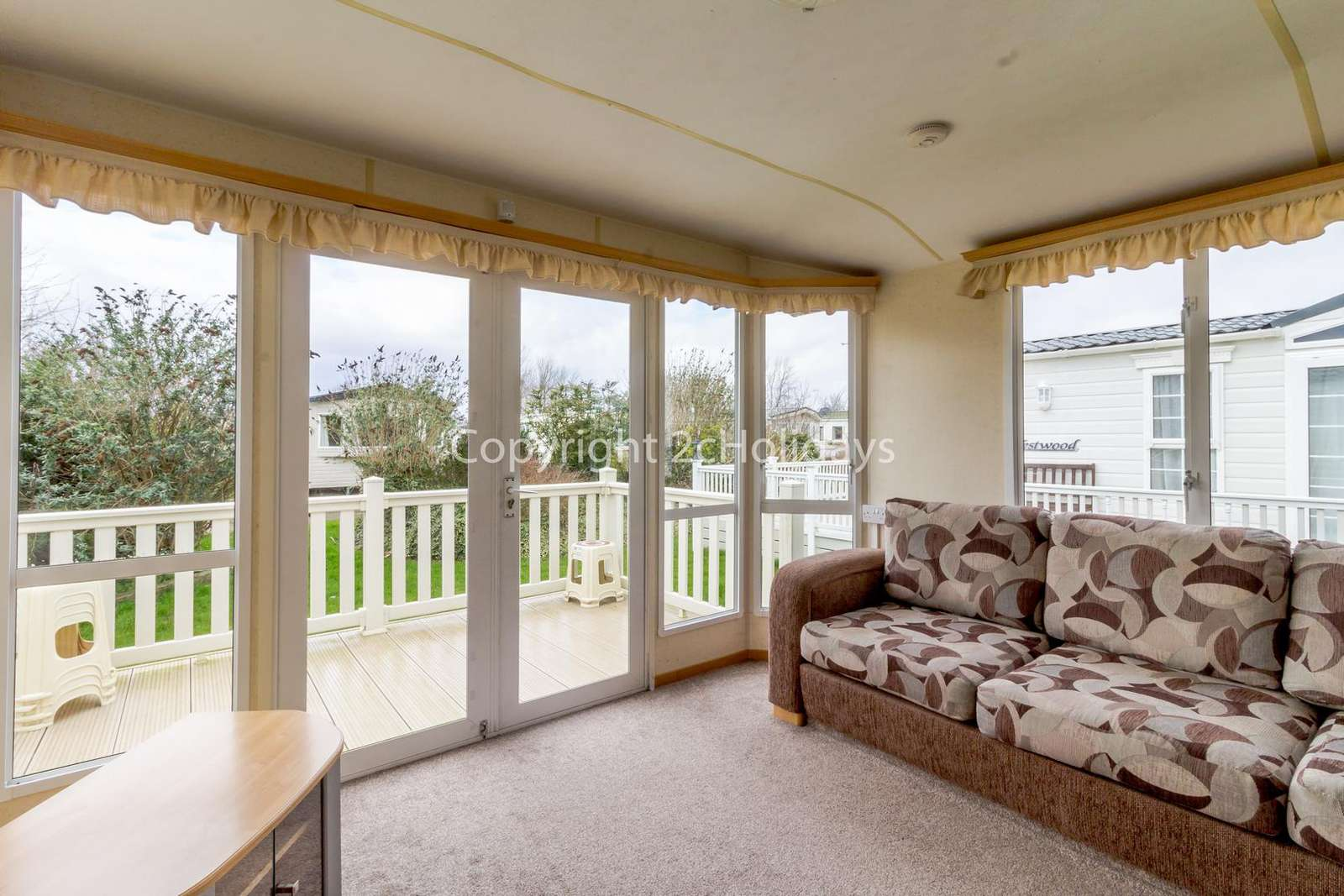 Spacious lounge with patio doors leading onto the decking!