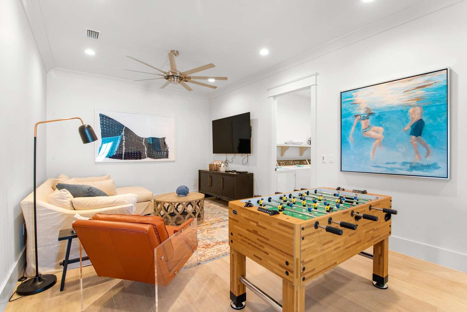 2nd floor den w/65 Smart TV and Foos Ball Table